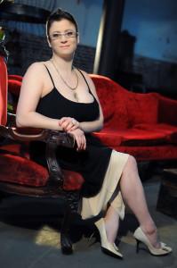 sitting, black and cream dress